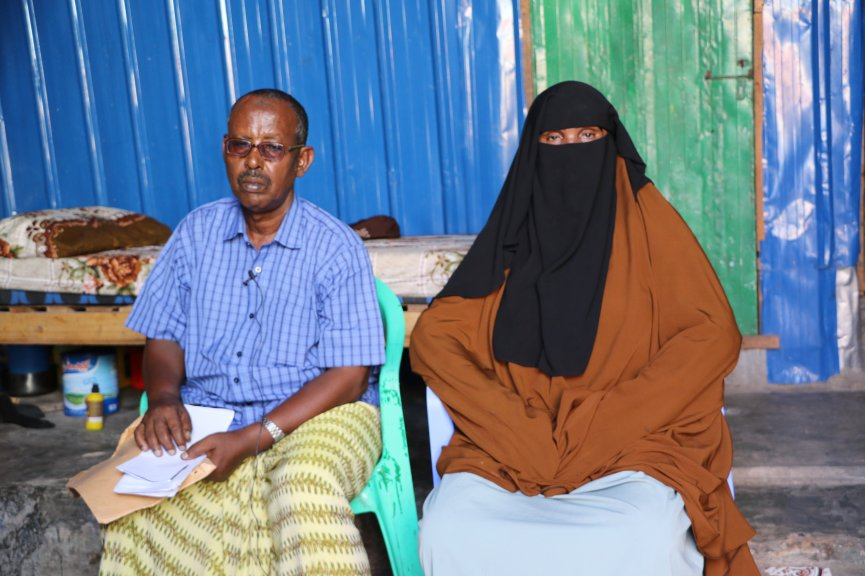 Qasim Iman, 59-year-old father and his wife Sahra Ismail, 53, say they are still waiting for government to rigorously investigate the killing of their son, Abdirizak Qasim Iman, a camera-journalist killed in Mogadishu by a police officer. (PHOTO by Hinda Dahir on Friday July 24, 2020).