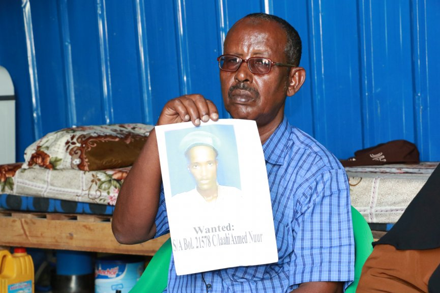 Qasim Iman, 59-year-old father presents photo of a police officer who shot dead his son, Abdirizak Qasim Iman, a camera-journalist killed in Mogadishu. (PHOTO by Hinda Dahir on Friday July 24, 2020).